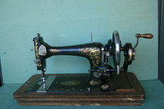 Very old hand sewing machine.