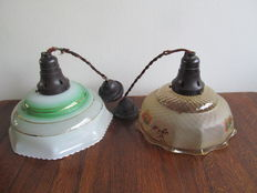 Two art deco hanging lamps, glass and bakelite