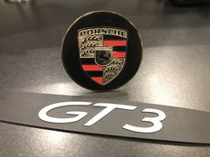 Lot with a Porsche Original 911 GT3 Door sill and a Porsche metal grill badge