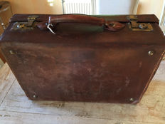 Small travel suitcase made of cowhide leather