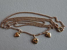 14 kt Gold necklace with three gold hearts 18 kt