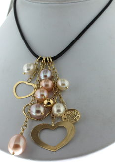 Gold necklace with a leather cord and set with freshwater pearls and a heart
