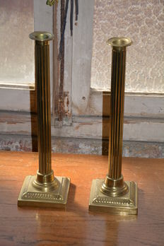 Pair of bronze candlesticks, ca. 1920 in Roman style.
