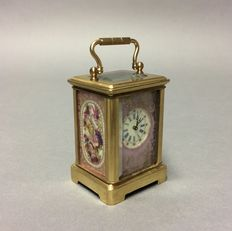 Small brass carriage clock with porcelain -- Period late 20th century