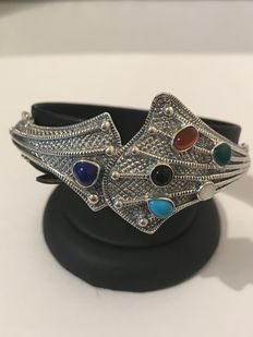 Silver women's bracelet with natural stones: emerald, sapphire, moonstone, turquoise, carnelian.