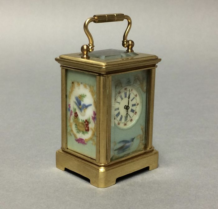 Miniature brass carriage clock with birds on porcelain -- Period late 20th century