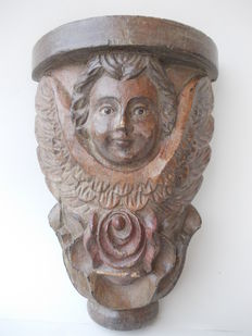 Antique capital carved in walnut wood depicting an angel's face with glass eyes - Italy - late 19th century