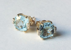 Ear studs made of gold with topazes and diamonds