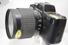 Pentax auto 110 super camera with auto Zoom 20-40mm and 2 objectives , 3x filters and flash