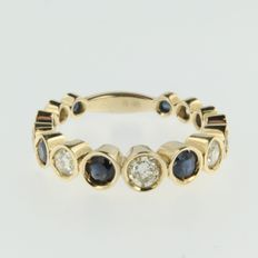 Gold ring of 14 kt with brilliant cut diamonds and sapphires of 1.65 ct