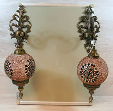 A set of two hand-inlaid glass mosaic wall lamps with brass wall mounts
