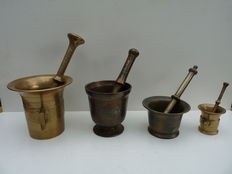 Four beautiful antique mortars with pestles.