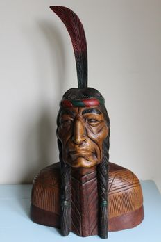 Bust carved wood Indian with feather