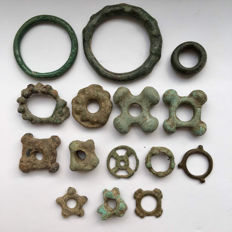 Celtic- 15 various Coins/Proto-Money from the Celtic era - bronze ring money.  18 mm / 48 mm (15)