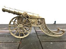 Attractive heavy antique yellow-copper cannon with the image of a coat-of-arms