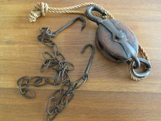 Old wooden pulley and copper coal scoop