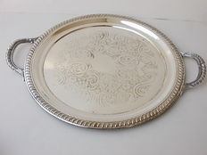 Nice round tray with carvings and two cast handles in English silver, punched with Trade Mark F.B. Brogers, made in UK, approximately 1900