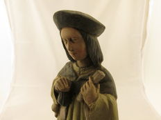 Sculpture of a medieval money usurer