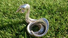 coiled cobra paperweight by christofle
