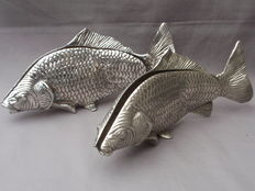 Two silver plated napkin holders in the form of a fish