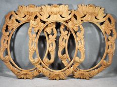 Set of three oval hand-carved wood frames