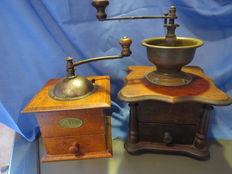 Two coffee grinder.