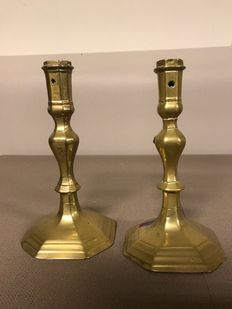 A pair of brass candlesticks-England-early 18th century