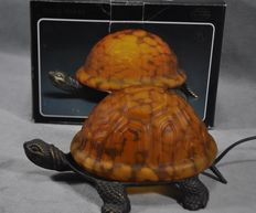 Tortoise-shaped bronze lamp with glass lampshade