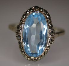 Art Deco handcrafted silver ring for ladies with a central natural Aquamarine surrounded by marcasites on the border