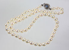 A necklace with Japanese Akoya pearls and opal