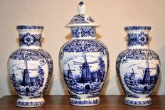 Beautiful three piece garniture with Delft blue windmills