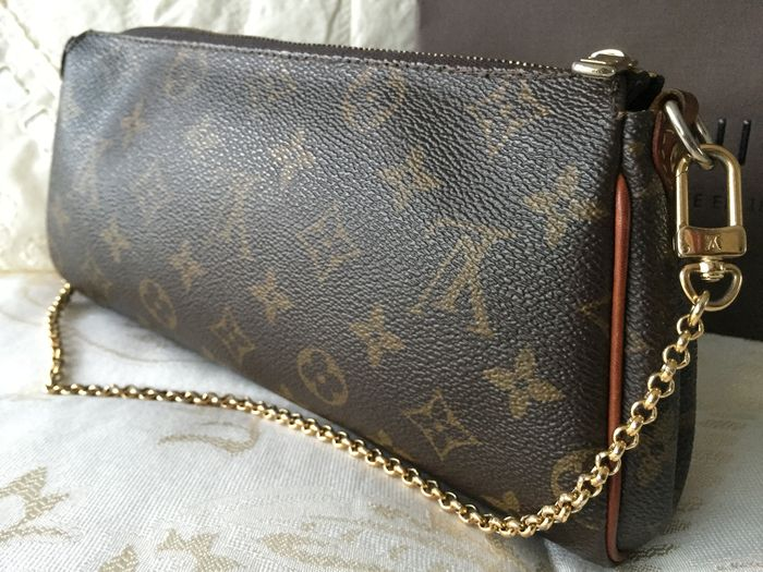 49a11ebb6b4 Louis Vuitton - Monogram Canvas Eva Clutch Bag - Catawiki