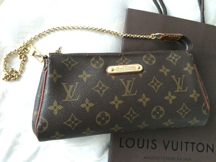 f20bce08d Louis Vuitton - Monogram Canvas Eva Clutch Bag - Catawiki