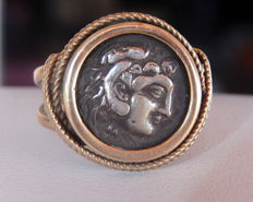 Yellow gold men's signet ring with a genuine antique coin.