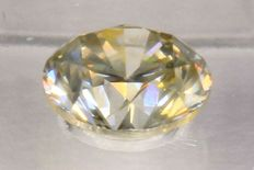 0.62 ct brilliant cut diamond light yellow brown SI2