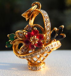 Superb 18 kt pendant in the shape of a basket of flowers, with diamonds, rubies, emeralds and sapphires.