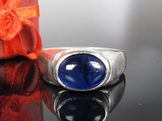 A silver ring with a sapphire, handmade in Germany