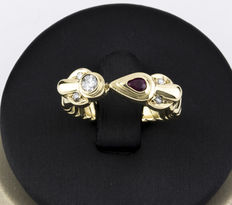 Ring in yellow gold with brilliant cut diamonds and one pear cut ruby