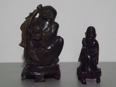One Sculpted Figurine in Black Quartz and Another in Soapstone Depicting a Wise Man - Mid-20th Century.