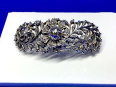Silver openworked brooch with rose cut diamonds. Approx. 1860
