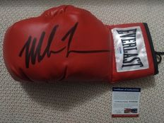 Original Everlast boxing glove signed by Iron Mike Tyson with PSA/DNA Certificate of Authenticity.