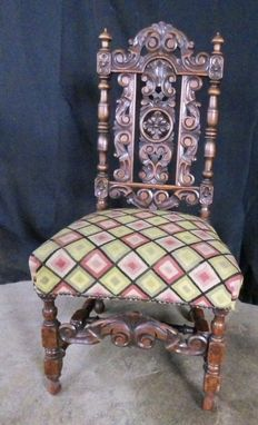 Antique carved wood and fabric chair