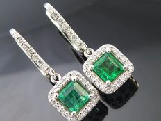 18 kt white gold earrings set with 2 intense green emeralds, 0.90 ct in total, and 54 brilliant cut diamonds, 0.30 ct in total