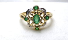14 kt Women's gold ring with emeralds and diamonds