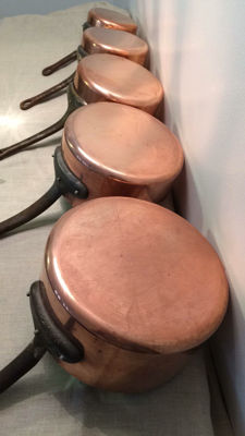 Five copper pans