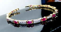 A yellow gold bracelet with rubies and diamonds