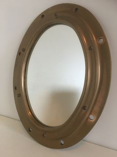 Antique very heavy brass porthole with mirror