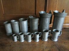 12 Pewter measuring jugs - European - 19th and 20th century