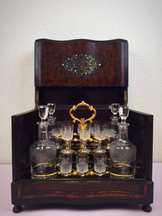 A Napoleon III bois noirci, burr-walnut and rosewood liqueur cellar - with brass and mother of Pearl inlay - France - circa 1880