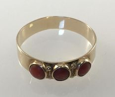 Gold women's ring with red coral